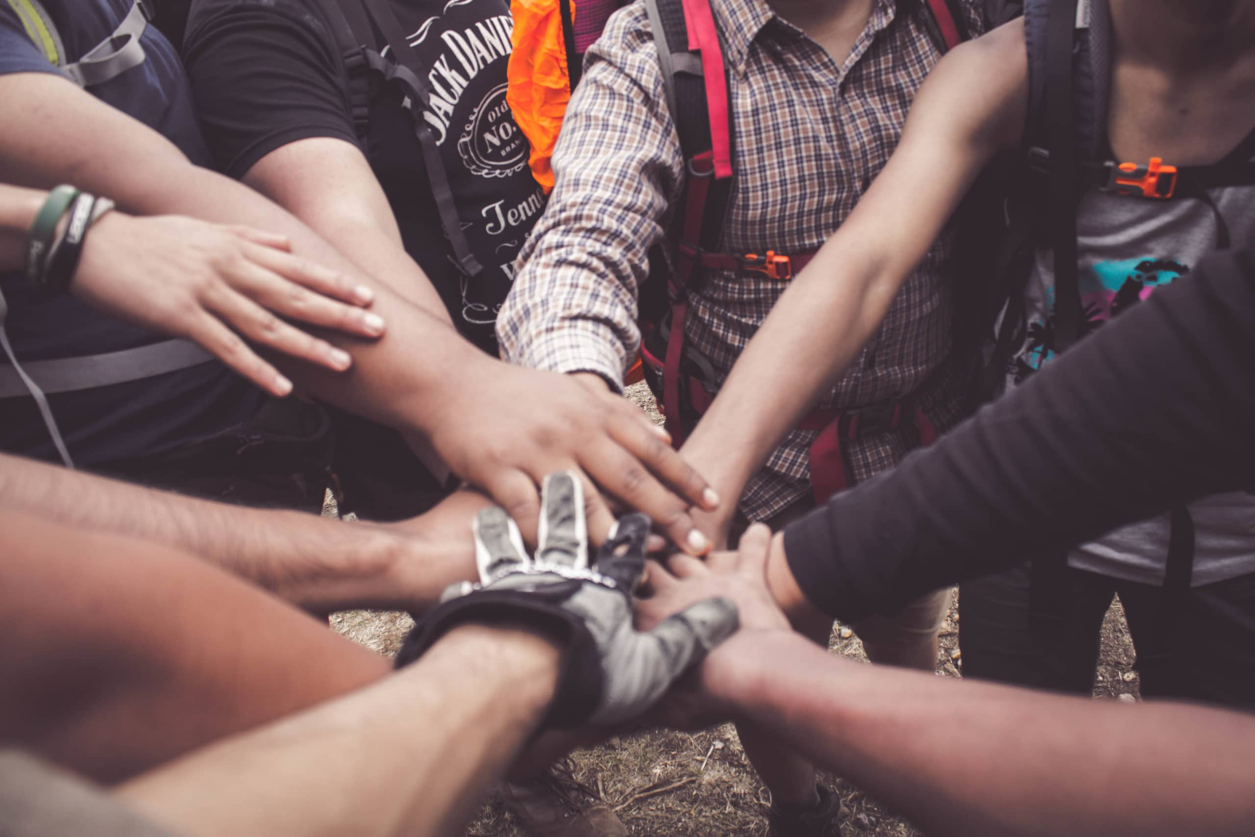 people-doing-group-hand-cheer